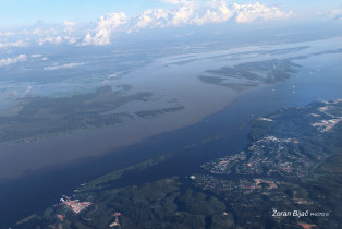 Meeting Of Waters Near Manaus. The Confluence Between Almost  The Black Colored Rio Negro And The Sandy-Colored Rio Solimões Makes Amazon River, Amazonas, Brazil